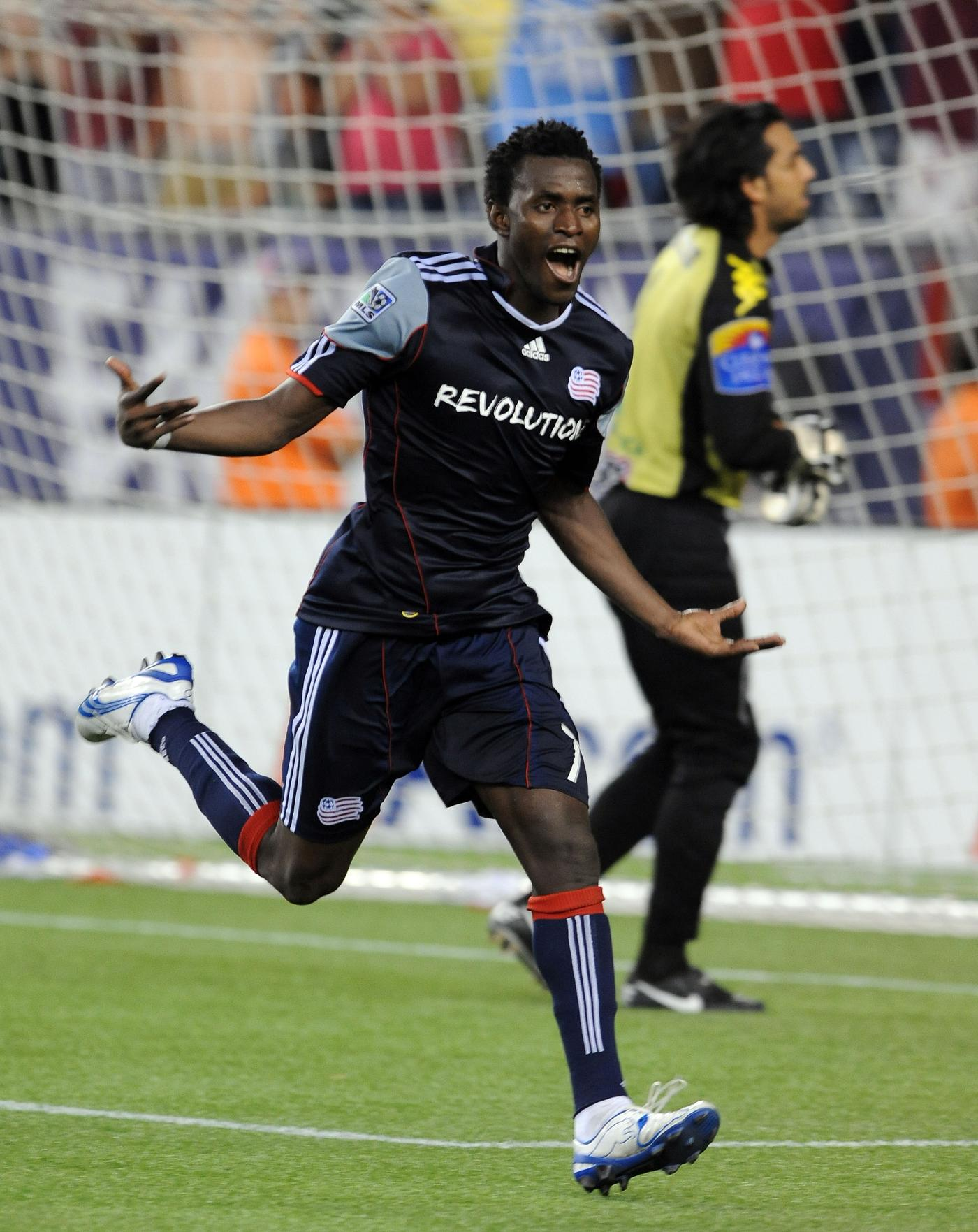 Kenny Mansally celebrates the successful penalty kick which sent the Revs to the SuperLiga 2010 final